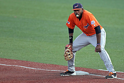 17 August 2013:  Kenny Bryant blows a respectable bubble with his gum as he mans first base during a Frontier League Baseball game between the Rockford Aviators and the Normal CornBelters at Corn Crib Stadium on the campus of Heartland Community College in Normal Illinois