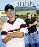 """CHICAGO, IL - JUNE 24:  Todd Frazier #21 of the Chicago White Sox """"photo bombs"""" a young fans photo during batting practice at U.S. Cellular Field on June 24, 2016."""