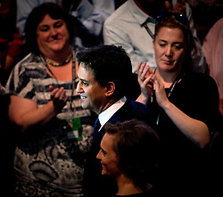 © London News Pictures. 24/09/2013 . Brighton, UK.  ED Labour party leader ED MILIBAND and wife JUSTINE THORNTON  leaving the stage after ED MILIBAND delivered his Key-note speech on the third day of the Labour Party Conference in Brighton. Photo credit : Ben Cawthra/LNP