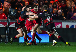 Scarlets' Tom Prydie is tackled by Dragons' Aaron Wainwright and Sam Beard<br /> <br /> Photographer Craig Thomas/Replay Images<br /> <br /> Guinness PRO14 Round 13 - Scarlets v Dragons - Friday 5th January 2018 - Parc Y Scarlets - Llanelli<br /> <br /> World Copyright © Replay Images . All rights reserved. info@replayimages.co.uk - http://replayimages.co.uk