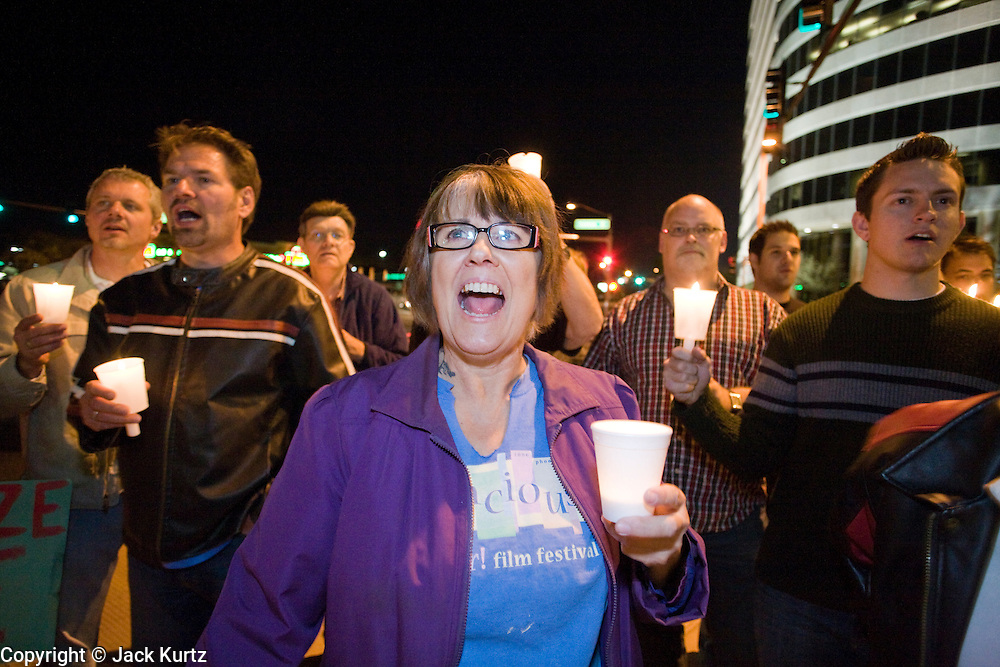 November 10, 2008 -- PHOENIX, AZ:  A woman holds up a candle during a gay rights vigil in Phoenix, AZ, Monday. About 250 people attended a candle light vigil in support of gay rights and gay marriage in Phoenix, AZ, Monday night. The rally, like similar ones in Los Angeles and Salt Lake City, were in response to anti-gay marriage and anti-gay rights initiatives that were passed by the voters in Arizona, California and Florida. The anti-gay initiatives in Arizona and California were funded by conservative churches, including the Church of Latter Day Saints (Mormons). Photo by Jack Kurtz / ZUMA Press