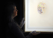©London News pictures. 07.02.2011. Penny Day, Head of Irish Art at Bonhams, looks at a portrait of Francis Bacon by Louis Le Brocquy. Irish Art on display at Boham's today (07/02/11) ahead of its sale. Highlights include a portrait of Francis Bacon, one of Britain's leading 20th century artists, painted by one of his friends, Louis Le Brocquy. The watercolour, titled Image of Francis Bacon No 18, is estimated to sell for £60,000 to £80,000. The sale is held on February 8th. Bonhams, 101 New Bond Street, London, UK.. Picture Credit should read Stephen Simpson/LNP