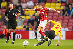 Bristol City's Gary O'Neill (left) and Watford's Ben Watson battle for the ball during the Carabao Cup, Second Round match at Vicarage Road, Watford.