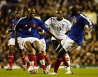 Photo: Chris Ratcliffe.<br /> England v France. U21 European Championships.<br /> 11/11/2005.<br /> Darren Ambrose gets in between Ronald Zubar, Jean Michel Badiane
