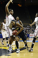 24 MARCH 2009: Georgia Tech guard Jacqua Williams (1) tries to drive around Oklahoma center Courtney Paris (3) during an NCAA Women's Tournament basketball game Tuesday, March 24, 2009, at Carver-Hawkeye Arena in Iowa City, Iowa. Oklahoma defeated Georgia Tech 69-50.