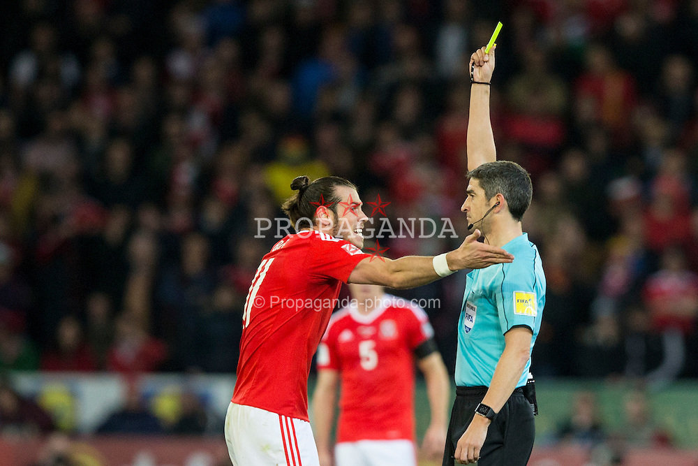CARDIFF, WALES - Saturday, November 12, 2016: Wales' Gareth Bale is shown a yellow card by referee Alberto Mallenco during the 2018 FIFA World Cup Qualifying Group D match  against Serbia at the Cardiff City Stadium. (Pic by David Rawcliffe/Propaganda)