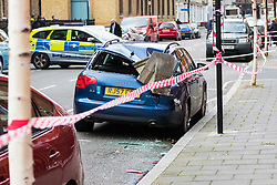 London, January 03 2018. The strong winds of storm Eleanor have blown large chunk of masonry from the gables of a mansion block, York House, in York Street, Marylebone, London. destroying an expensive Audi A4 Estate, with police having cordoned off the scene. © SWNS