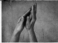 Upraised hands forming universal prayer form.