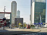 Verkeer met auto's en openbaar vervoer aan de Wilhelminakade op de Kop van Zuid, Rotterdam - Traffic with cars and public transport at the Kop van Zuid, Rotterdam, Netherlands