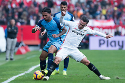 December 16, 2018 - Seville, Andalucia, Spain - Roque Mesa of Sevilla FC and Douglas Luiz of Girona CF competes for the ball during the LaLiga match between Sevilla FC and Girona at Estadio Ramón Sánchez Pizjuán on December 16, 2018 in Seville, Spain  (Credit Image: © Javier MontañO/Pacific Press via ZUMA Wire)