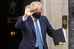 © Licensed to London News Pictures. 12/05/2021. London, UK.  British Prime Minister BORIS JOHNNSON, leaves Downing Street for the Houes of Parliament to make a statement on Covid 19 and proposals for an independent public enquiry. Photo credit: London News Pictures