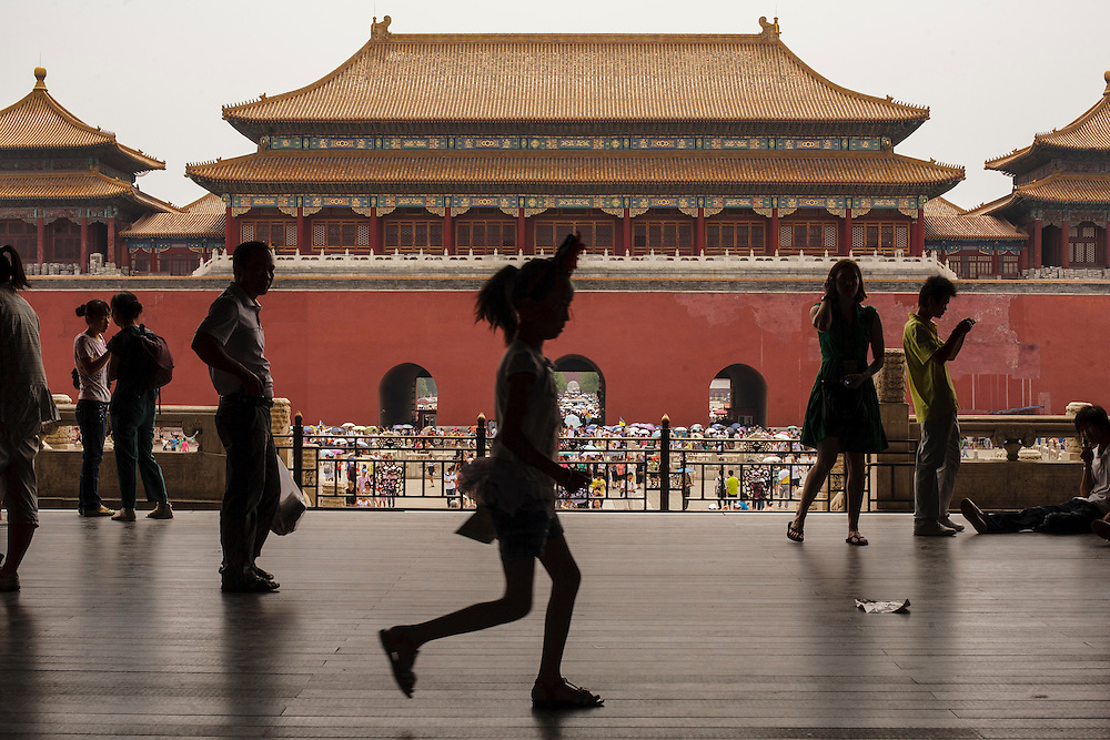 A girl plays inside the Forbidden City in Beijing.