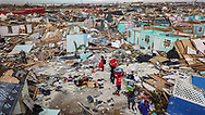 Survivors salvage supplies from homes destroyed by the wind and storm surge caused by Hurricane Dorian in an area called 'The Mudd' on Thursday, September 5, 2019 at Marsh Harbour in Great Abaco Island, Bahamas