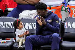 May 6, 2018 - New Orleans, LA, U.S. - NEW ORLEANS, LA - MAY 06:   New Orleans Pelicans guard Jrue Holiday (11) takes a moment to play with his daughter, Jrue Tyler, during game 4 of the NBA Western Conference Semifinals at Smoothie King Center in New Orleans, LA on May 06, 2018.  (Photo by Stephen Lew/Icon Sportswire) (Credit Image: © Stephen Lew/Icon SMI via ZUMA Press)