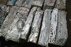 Baled aluminium and copper car radiators from commercial vehicles at metal recycling centre,