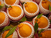 Japan, Tokyo food market Individually wrapped oranges