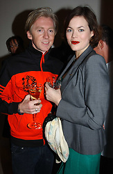 Milliner PHILIP TREACY and  JASMINE GUINNESS at a party to celebrate the opening of Jasper Conran's new shop and HQ at 36 Sackville Street, London W1 on 15th February 2005.<br /><br />NON EXCLUSIVE - WORLD RIGHTS