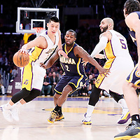 04 January 2014: Los Angeles Lakers guard Jeremy Lin (17) drives past Indiana Pacers guard Rodney Stuckey (2) on a screen set by Los Angeles Lakers forward Carlos Boozer (5) during the Los Angeles Lakers 88-87 victory over the Indiana Pacers, at the Staples Center, Los Angeles, California, USA.