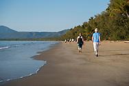People enjoy an early morning walk on Four Mile Beach in Port Douglas, Queensland, Australia.