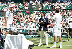 LONDON, ENGLAND - Wednesday, July 1, 2009: Ivo Karlovic (CRO) (L) and Roger Federer (SUI) during the Gentlemen's Singles Quarterfinal on day nine of the Wimbledon Lawn Tennis Championships at the All England Lawn Tennis and Croquet Club. (Pic by David Rawcliffe/Propaganda)