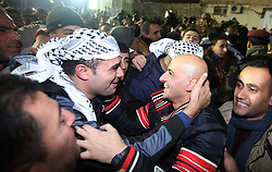 60875567<br /> Palestinian relatives of the newly released prisoners celebrate upon their arrival in the West Bank city of Ramallah, on Dec. 31, 2013. Israel freed 26 Palestinian prisoners early Tuesday, as part of a U.S.-brokered agreement to resume direct peace talks between the two sides, Tuesday, 31st December 2013. Picture by  imago / i-Images<br /> UK ONLY