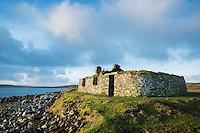 Derelict traditional blackhouse ruin near coast, Berneray, Outer Hebrides, Scotland
