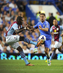 "Aston Villa's Christian Benteke battles for the ball with Chelsea's Branislav Ivanovic  - Photo mandatory by-line: Joe Meredith/JMP - Tel: Mobile: 07966 386802 21/08/2013 - SPORT - FOOTBALL - Stamford Bridge - London - Chelsea V Aston Villa - Barclays Premier League - EDITORIAL USE ONLY. No use with unauthorised audio, video, data, fixture lists, club/league logos or ""live"" services. Online in-match use limited to 45 images, no video emulation. No use in betting, games or single club/league/player publications"