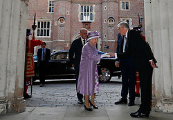 Queen Elizabeth II and the Duke of Edinburgh arrive to attend Evensong in celebration of the centenary of the Order of the Companions of Honour at the Chapel Royal Hampton Court Palace in southwest London.