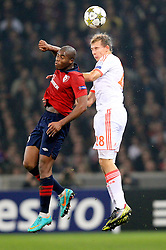 23.10.2012, Grand Stade Lille Metropole, Lille, OSC Lille vs FC Bayern Muenchen, im Bild Kopfballduell zwischen Djibril SIDIBE (OSC Lille - 15) und Holger BADSTUBER (FC Bayern Muenchen - 28) // during UEFA Championsleague Match between Lille OSC and FC Bayern Munich at the Grand Stade Lille Metropole, Lille, France on 2012/10/23. EXPA Pictures © 2012, PhotoCredit: EXPA/ Eibner/ Ben Majerus..***** ATTENTION - OUT OF GER *****