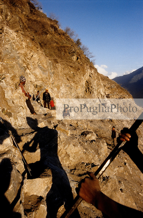 """Kalikot, 08 March 2005.  At few kilometres from Manma, a road is under construction. """"""""The road is for us, the RNA and the Police Force. Once completed, it will be easier to get to the Maoist areas"""" a Police inspector from Manma says. In most of the Kalikot's area, walking is the only method of transport. Donkeys are also used for moving cargo."""