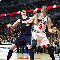 26 March 2012: Denver Nuggets center Timofey Mozgov (25) vies for the rebound with Chicago Bulls center Omer Asik (3) during the Denver Nuggets 108-91 victory over the Chicago Bulls at the United Center, Chicago, Illinois, USA. NOTE TO USER: User expressly acknowledges and agrees that, by downloading and or using this photograph, User is consenting to the terms and conditions of the Getty Images License Agreement. Mandatory Credit: 2012 NBAE (Photo by Chris Elise/NBAE via Getty Images)