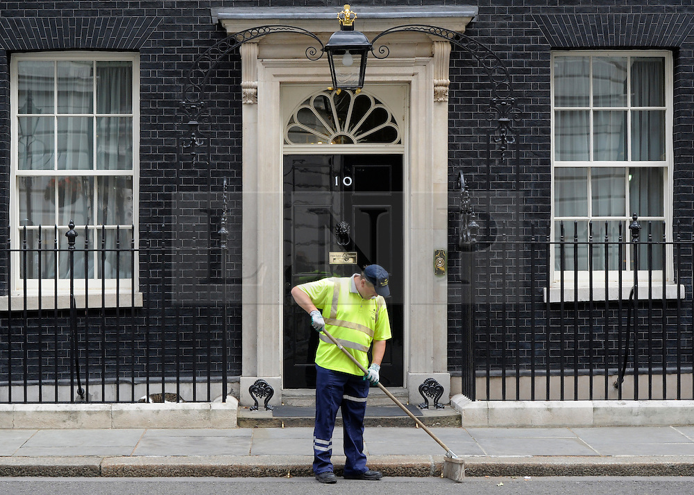 © Licensed to London News Pictures. 26/06/2012. Westminster, UK    A street cleaner on Downing Street today 26th June 2012. Photo credit : Stephen Simpson/LNP