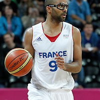 02 August 2012: France Tony Parker brings the ball upcourt during 82-74 Team France victory over Team Lithuania, during the men's basketball preliminary, at the Basketball Arena, in London, Great Britain.