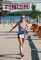 Kristina Folcik crosses the finish line during the GLCAC Marshmallow Man Sprint Triathlon at Opechee Park Sunday morning.  (Karen Bobotas/for the Laconia Daily Sun)