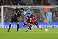 Football - 2019 / 2020 Premier League - Southampton vs. Crystal Palace<br /> <br /> Luka Milivojevic of Crystal Palace fouls Southampton's Sofiane Boufal during the Premier League match at St Mary's Stadium Southampton <br /> <br /> COLORSPORT/SHAUN BOGGUST