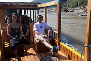 Boat trip up to the Thousand Buddha Caves on the Mekong River, Luang Prabang, Laos.