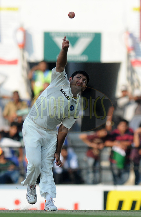 Piyush Chawla of India bowls during day one of the 4th Airtel Test Match between India and England held at VCA ground in Nagpur on the 13th December 2012..Photo by  Pal Pillai/BCCI/SPORTZPICS .