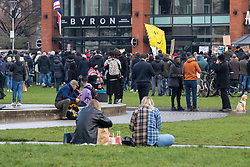 © Licensed to London News Pictures. 06/12/2020. Manchester, UK. People enjoy a picnic in Piccadilly Gardens during a Rise Up protest in Manchester. Photo credit: Kerry Elsworth/LNP