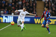 Angel Rangel of Swansea city (l) in action. Barclays Premier league match, Swansea city v Crystal Palace at the Liberty Stadium in Swansea, South Wales on Saturday 6th February 2016.<br /> pic by Andrew Orchard, Andrew Orchard sports photography.