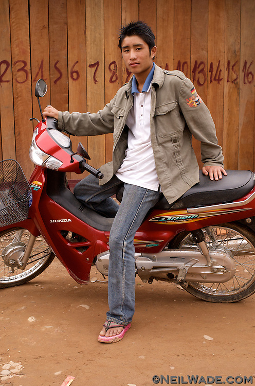 """No matter how far out you might be in the most remote regions of the world, you always seem to find teen-aged kids who are trying to be """"cool"""". This young man was happy to see me so he could practice his English and show off his nice scooter."""