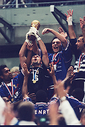 France's goalkeeper Fabien Barthez, flanked by Alain Boghossian and Christian Karembeu, rises the trophy after the FIFA football world cup France v Brazil final match at the Stade de France stadium in Saint-Denis, near Paris, France, July 12, 1998. France won 3-0. Photo by Lionel Hahn/ABACAPRESS.COM