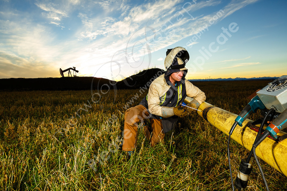 On-location commercial photography for Up in Smoke Welding Apparel. The purpose of the shoot was to create marketing images for a new line of industrial strength pants that were being worn during a pipeline welding job in progress.<br /> <br /> ©2016, Sean Phillips<br /> http://www.RiverwoodPhotography.com