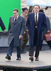 """Screen Legends Robert De Niro and Al Pacino are pictured filming their upcoming Martin Scorsese's Mob Drama """"The Irishman"""" in the Bronx. De Niro wore high platform shoes in one of the scenes to make himself appear bigger next to Pacino. Ray Romano is also pictured next to the lengendary actors. 20 Dec 2017 Pictured: Al Pacino and Robert De Niro. Photo credit: LRNYC / MEGA TheMegaAgency.com +1 888 505 6342"""