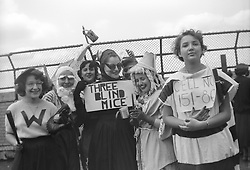 Girls dressed in costumes at a  college pep rally