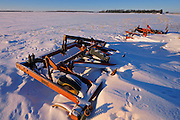 Farm machinery in winter field of snow<br />