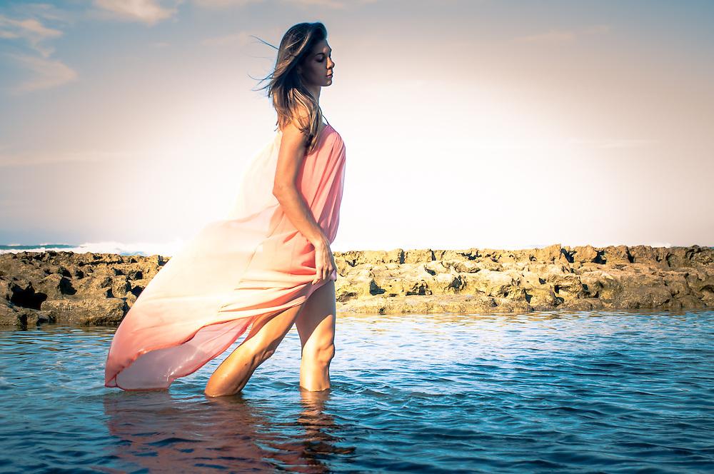 Wading Woman in the ocean in sun lite dress