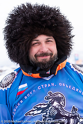 Moscow motorcycle mechanic Alexander Pikalo who rode the 6,000 km from Moscow to Baikal at the Baikal Mile Ice Speed Festival. Maksimiha, Siberia, Russia. Thursday, February 27, 2020. Photography ©2020 Michael Lichter.