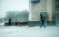 MOSCOW - CIRCA MARCH 2013: Snow storm in the streets of Moscow with people in the streets, circa 2013. With a population of more than 11 million people is one the largest cities in the world and a popular tourist destination.