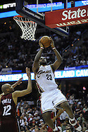 LeBron James of Cleveland is guarded by Kasib Powell..The Miami Heat lost to the host Cleveland Cavaliers 84-76 at Quicken Loans Arena, April 13, 2008...