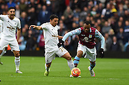 Jefferson Montero of Swansea city holds off Jordan Ayew of Aston Villa. .Barclays Premier league match, Aston Villa v Swansea city at Villa Park in Birmingham, the Midlands on Saturday 24th October 2015.<br /> pic by  Andrew Orchard, Andrew Orchard sports photography.